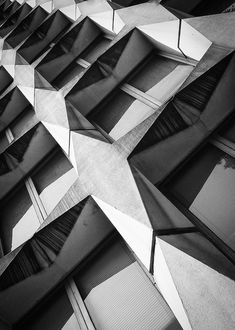 Geometric patterns in architecture with graphic contrast & repetition.